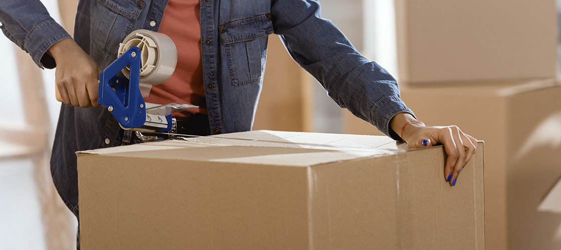 Woman packing moving boxes