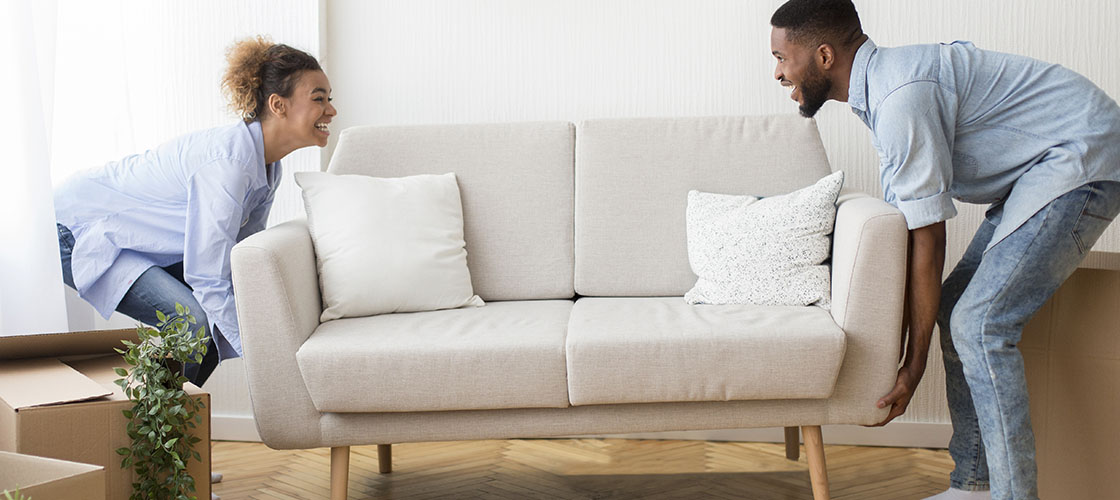 Couple moves couch in new home