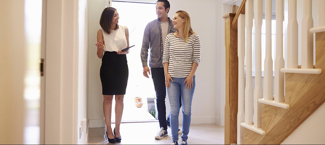 Real estate agent walks couple through openhouse